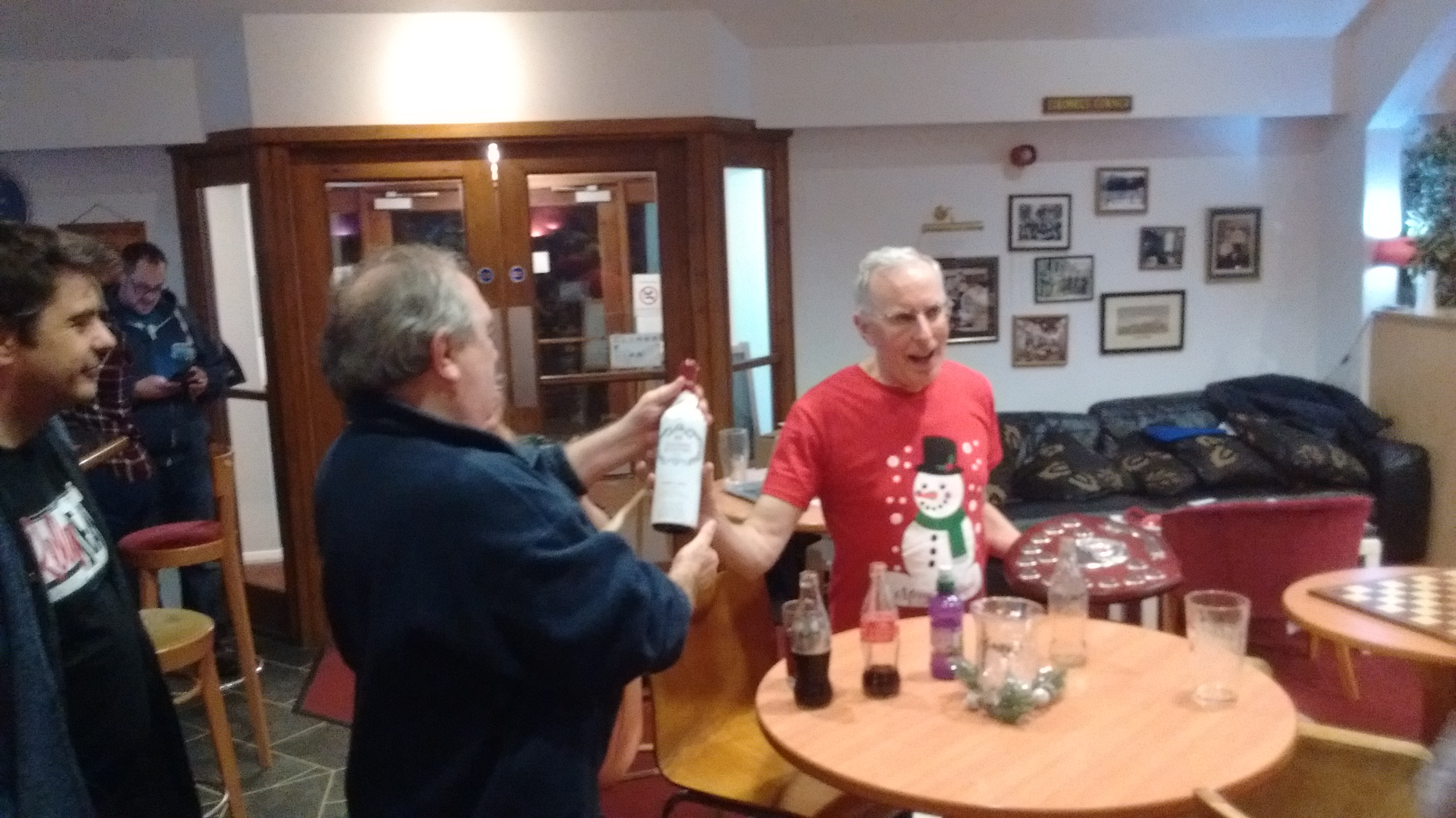 Ken receives the coveted wooden spoon (and a bottle of wine)